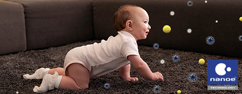 Image of a baby crawling in a room, where PM10 and dust can negatively impact health and wellness.