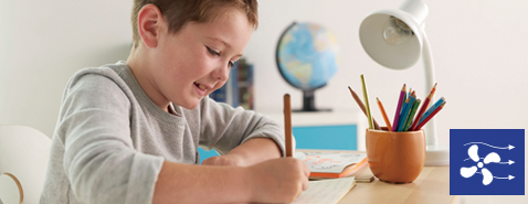 Image of a child is concentrating on his studies.