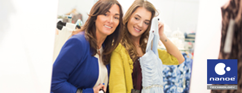 Image of two women are enjoying shopping together.