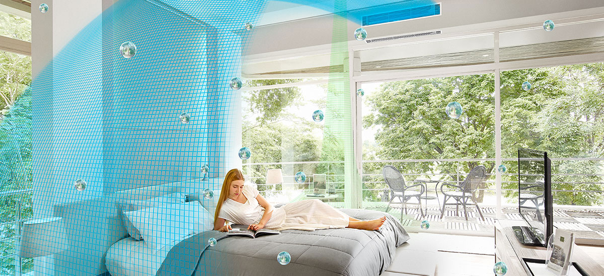 Image showing how outstanding air quality management helps a woman feel comfortable as she relaxes in bed with a magazine.