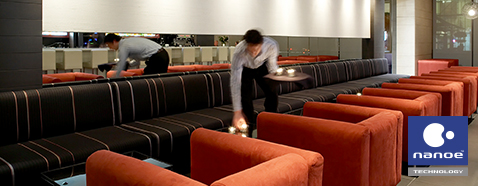 The picture of restaurant staff cleaning fabric sofa.