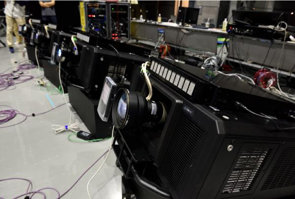 Photo: Four high-speed projectors were used for the opening performance at the 1 Year to Go! ceremony.