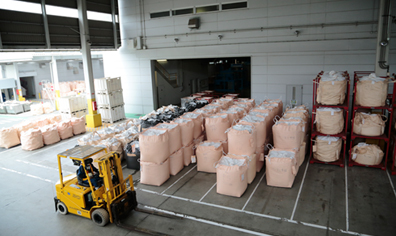 Photo: Recycled materials are shipped from PETEC. Forklifts are carrying recycled materials loaded into bags.