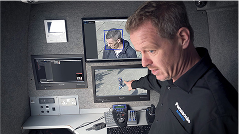Photo: Panasonic employee navigating facial recognition system screen