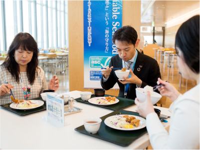 Photo: Panasonic employees eating from the menu of the sustainable seafood corporate cafeteria.