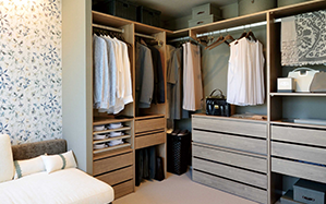 Closet with convenient storage spaces to keep fashion items.