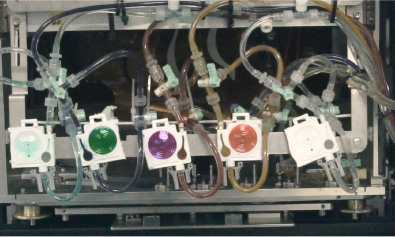 Photo: The interior of an Ink-jet printer used to print special cosmetic ink onto a Make-up Sheet. Green, purple, orange, etc., cosmetic ink is set.
