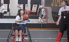 Photo: Trying wheelchair basketball