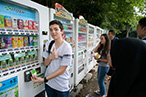 Photo: Using IC card to buy soda from a vending machine