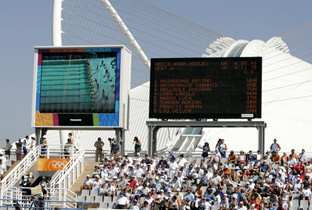Photo: Swimming competition and score board being shown on ASTROVISION large display units installed at a venue of the Olympic Games Athens 2004