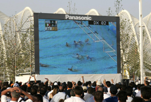 Photo: Swimming competition being shown on an ASTROVISION large display unit installed near a venue of the Olympic Games Athens 2004