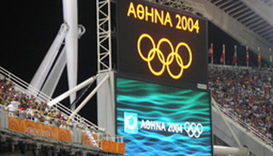 Photo: The Olympic rings and Olympic Games Athens 2004 emblem being shown on ASTROVISION large display units installed at a venue of the Olympic Games Athens 2004