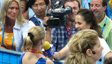 Photo: Cameraperson using a camera recorder to film an athlete being interviewed at one of the venues of the Olympic Games Athens 2004