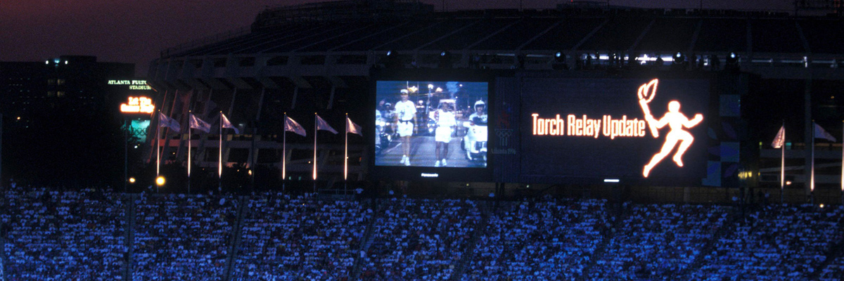 Photo: Torchbearer shown on an ASTROVISION large display unit installed at the main stadium of the Olympic Games Atlanta 1996