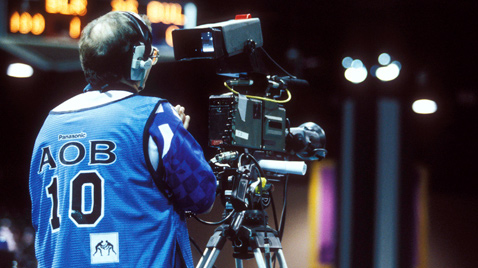 Photo: Cameraperson using a camera recorder at one of the venues of the Olympic Games Atlanta 1996