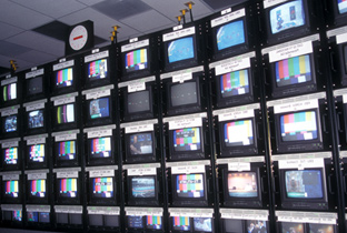 Photo: Images being shown on multiple monitors installed at the International Broadcast Center (IBC)