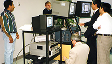 Photo: Panasonic engineers using multiple monitors and equipment to check slow motion images