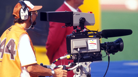 Photo: Cameraperson using a video camera recorder at one of the venues of the Olympic Games Barcelona 1992