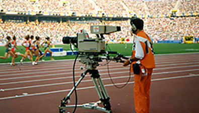 Photo: Cameraperson filming athletics athletes with a digital camera recorder at one of the venues of the Olympic Games Barcelona 1992