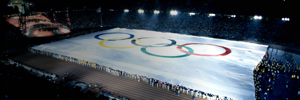 Photo: Gigantic Olympic flag completely covering the stadium's ground at the opening ceremony of the Olympic Games Barcelona 1992