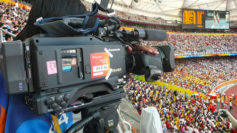 Photo: Cameraperson using an HD camera recorder at one of the venues of the Olympic Games Beijing 2008