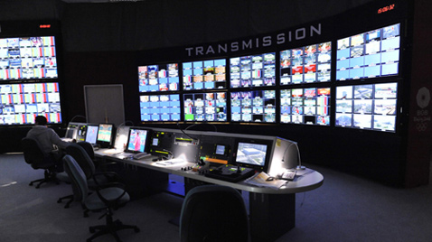 Photo: Staff working with multiple monitors at the International Broadcast Center (IBC)
