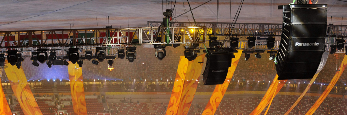 Photo: Professional RAMSA audio system equipment suspended from the ceiling of a venue of the Olympic Games Beijing 2008