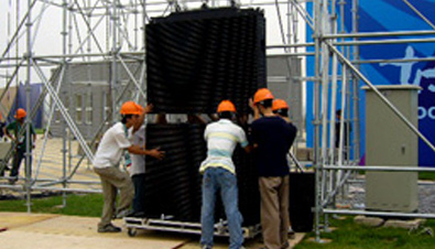 Photo: Staff installing an ASTROVISION large display unit at the construction site of one of the venues of the Olympic Games Beijing 2008