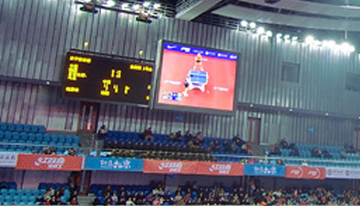 Photo: Score board and table tennis competition being shown on ASTROVISION large display units installed at the Peking University Gymnasium
