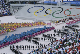 Photo: The Olympic rings drawn in the stands and performance by colorfully dressed dancers on the stadium's ground at the opening ceremony of the Olympic Winter Games Calgary 1988