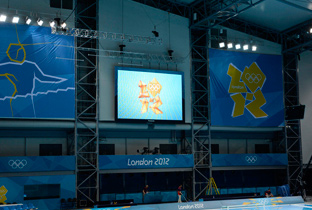 Photo: The Olympic Games London 2012 emblem being shown on a plasma display installed on the wall of a venue of the Olympic Games London 2012