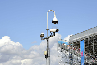 Photo: Outdoor security camera with housing and box-type security cameras enclosed in a housing installed near a venue of the Olympic Games London 2012