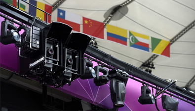 Photo: Compact DLP projectors installed alongside lighting equipment at a venue of the Olympic Games London 2012