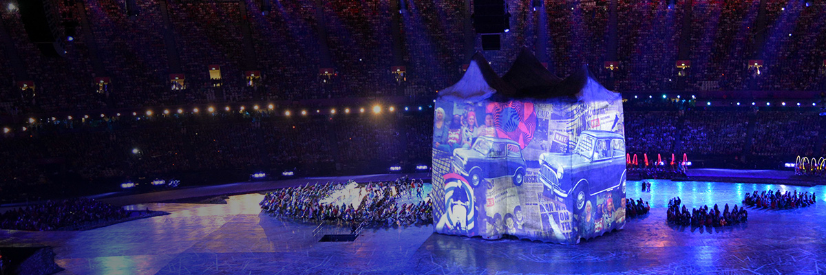 Photo: Images projected using DLP projectors are being shown on a large house at the center of the stadium during the opening ceremony of the Olympic Games London 2012