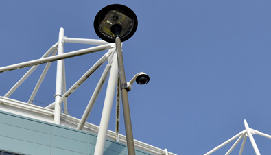 Dome-type security camera installed on a light post near a venue of the Olympic Games London 2012