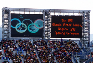Photo: The opening ceremony being shown on two ASTROVISION large display units installed at the opening ceremony venue of the Olympic Winter Games Nagano 1998