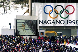 Photo: Ski jumping competition being shown on an ASTROVISION large display unit installed at a venue of the Olympic Winter Games Nagano 1998