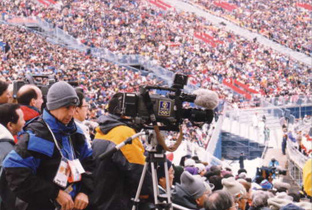 Photo: Cameraperson using a camera recorder at one of the venues of the Olympic Winter Games Nagano 1998