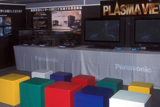 Photo: Editing equipment and monitors on display at the Panasonic broadcasting equipment exhibition booth