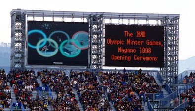 Photo: The opening ceremony being shown on two ASTROVISION large display units installed at a venue of the Olympic Winter Games Nagano 1998