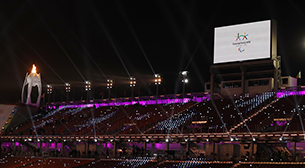 Photo of spectator seats and large video display equipment installed at a PyeongChang 2018 Paralympic Winter Games venue