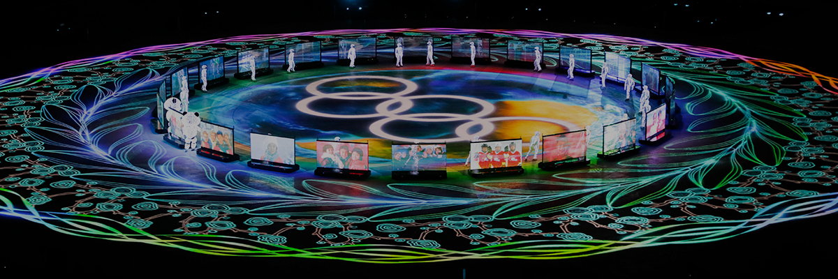 Photo of the PyeongChang 2018 Winter Games Closing Ceremony featuring bright, colorful light from the 30,000-lumen laser projector