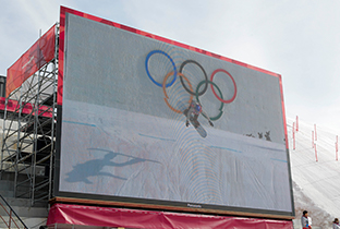Photo of snowboard competition video displayed on a large video display equipment installed at a PyeongChang 2018 Winter Games venue