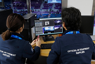 Photo of staff editing video for the multi-video streaming system