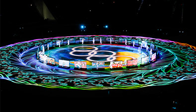 Photo of the PyeongChang 2018 Winter Games Closing Ceremony where laser projectors and projection mapping were used to create bright, colorful light