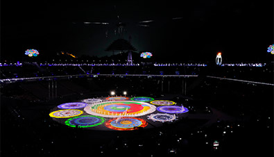 Photo of the PyeongChang 2018 Winter Games Closing Ceremony featuring bright, colorful light from the high brightness laser projector