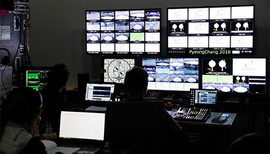 Photo of staff using a multiple unit surveillance system at the central control room to monitor the conditions of projectors and other equipment