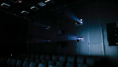 Photo of light beamed from four PT-RQ32K laser projectors at the NHK 8K theater inside the IBC