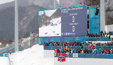 Photo: Scores, other information, and competition footage displayed on a combination board using the Large-Screen Display Systems at the Olympic Winter Games PyeongChang 2018 ski competition venue