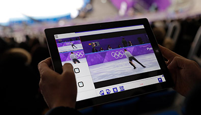 Photo: By using tablets at audience seats of the Games, they are watching the movie of figure skating through a the multi-video streaming system in a special application.